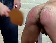 Strapped down, stripped naked, paddled red raw, cock-sucking training, anally fucked by his 2 tormentors.